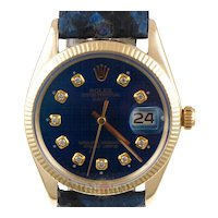 Pre-Owned 1970 Vintage 14kt Yellow Gold Rolex Date Watch With Blue Diamond Dial With Blue and Black Leather Band Model# 1503  PRICE - $3850.00