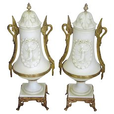 Pair of Antique German Porcelain and Bronze Mounted Urns