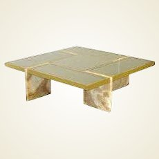 A Travertine Base, Brass & Mirrored Glass Cocktail Table