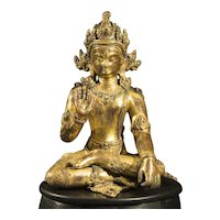A figure of a Bodhisattva, Gilt Bronze with semi-precious stone inlay, Nepal, 14th century