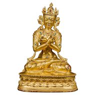 A gilt bronze figure of Vajradhara, Tibet, Circa 1400