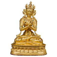 A gilt bronze figure of Vajradhara, Tibet, Circa 1400