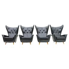 Four Black Leather Wing Lounge Chairs, 1950s