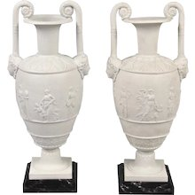 Pair of Bisque Neoclassical Urns on Later Bases