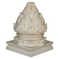 a large carved white marble carpet weight from India.