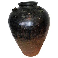 A Large Clay Pot or Vase in a Dark Glaze