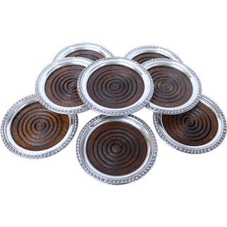 Set of Eight Sterling and Mahogany Coasters