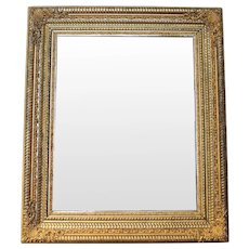German Ripple Carved and Gilded Mirror with Gilt Metal Mounts