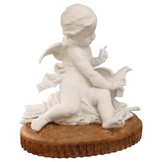 Late 19th Century French Bisque Porcelain (Parianware) Putto Figure on a Plinth
