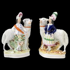 Pair of Staffordshire Scottish Figures with Large Sheep