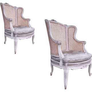 Pair of Large Antique Louis XVI Style Painted and Caned Wing Chairs