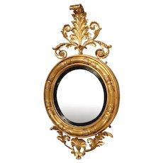 Late Regency Giltwood and Ebonised Convex Mirror