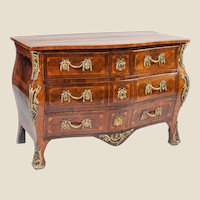 A George III Rosewood, Padouk and Gilt-Brass Mounted Commode