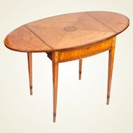 George III period satinwood and marquetry Pembroke table in the Sheraton manner
