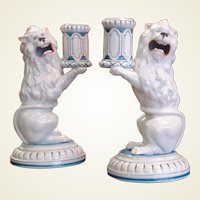 A Pair of Lion Form Candlesticks