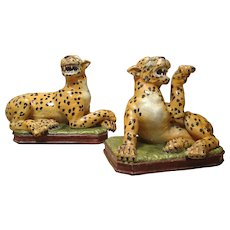 A Pair of Painted and Glazed Leopards