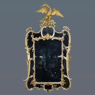 Chippendale period border glass mirror, retaining the original painted finish, with contemporary gilding. Circa 1755.