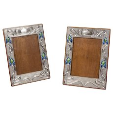 Pair of Art Nouveau Silver and Enamelled Photograph Frames