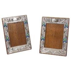 Pair of Art Nouveau Silver and Enamelled Photograph Frames