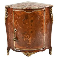 A French 18th Century Marquetry Corner Cupboard