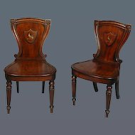 Pair George III Mahogany Hall Chairs with Painted Crests, in the Manner of Gillow (c. 1820 England)