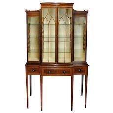 George III mahogany breakfront china cabinet with secretaire drawer, attributed to Gillows. England, c.1790.
