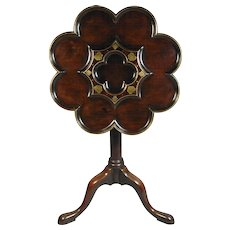 George II mahogany tripod table, the scalloped top inlaid with brass in the manner of Frederick Hintz. England, c.1730