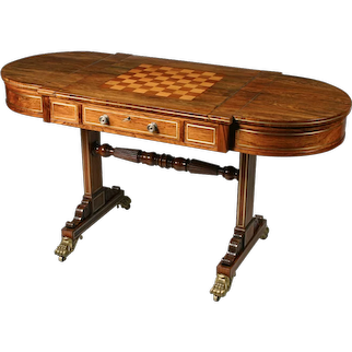 Regency brass inlaid rosewood games table with reversible top revealing a backgammon board. England, c.1810.