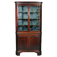George III period mahogany double corner cupboard with glazed upper part. England, c. 1780.