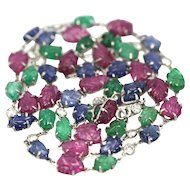 Deco Tutti Frutti 35.91 carats of Carved Sapphires, Emeralds, Rubies and Diamonds Platinum Necklace
