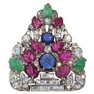 Art Deco Platinum Carved Ruby, Sapphire, Emerald and Diamond Tutti Frutti Pierced Shield Brooch