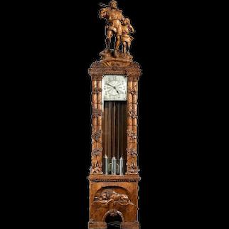 A 'Black Forest' linden wood long case clock by Spring of Interlaken