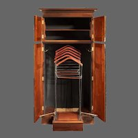 A rare Edwardian mahogany mechanical gentleman's wardrobe