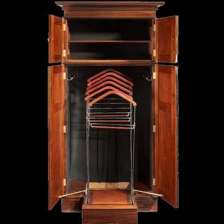 A rare Edwardian mahogany mechanical gentleman's wardrobe