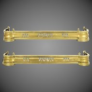 A pair of late Victorian brass kerb fenders