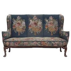 A Queen Anne style mahogany sofa