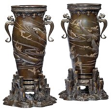 A pair of Meiji period bronze vases
