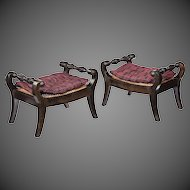 A pair of Anglo Indian solid ebony footstools,