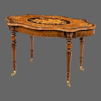 A Victorian burr walnut marquetry library table
