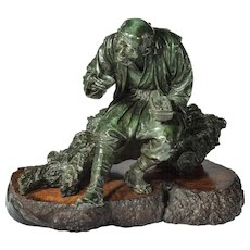A large Tokyo school bronze of a peasant by Udagawa Kazuo