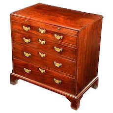 A George III mahogany chest of drawers with canted corners.
