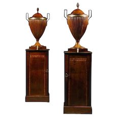 A pair of George III mahogany wine cisterns attributed to Gillows