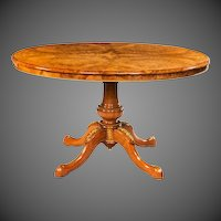 Burr walnut and ormolu mounted centre table with quartered veneered top.
