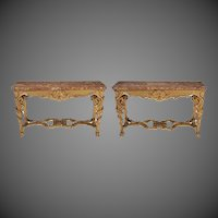 A pair of giltwood console tables with original marble tops