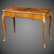 A mid Victorian burr walnut writing table