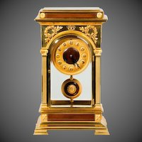 A Rectangular Four Glass Ormolu Mantel Clock