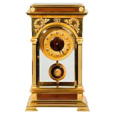 A Rectangular Four Glass Ormolu Mantel Clock