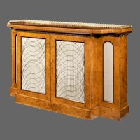 A Regency amboyna breakfront side cabinet