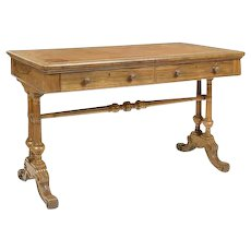 An early Victorian rosewood writing table by Holland & Sons