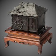 A signed bronze meiji period censor on hard wood stand.